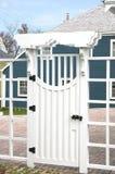 Ornate White Gate. Ornate wooden white gate stock photos