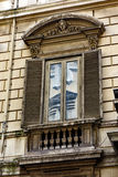 Ornate Window Detail on Classical Rome Building, Italy. Ornate and stained marble architraves on a double window on a classical original Rome building, with stock images