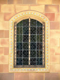 Ornate Window with wrought iron bars Royalty Free Stock Photo