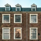 Ornate windows on a building in Harrogate, North Yorkshire stock photo