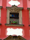 Ornate windows and ornaments on the outer walls of the old city Stock Photo