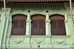 Ornate windows shutters and wall pattern Singapore Stock Photos