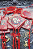 Ornate wishing cards hanging on a rack at a Buddhist temple, Beijing, China Stock Photo
