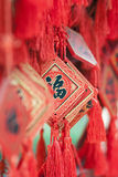 Ornate wishing cards hanging on a rack at a Buddhist temple, Beijing, China Royalty Free Stock Photos