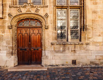 Ornate wooden double door of an old church. A beautifully ornate entry door of an old church in Compiègne, France. The building itself is made of stone blocks Royalty Free Stock Photography
