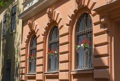 Ornate wrought iron window shutters Stock Image