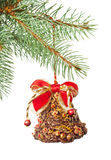 Ornate Xmas bell on fir twig isolated on white Royalty Free Stock Photos