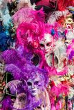Carnival masks with colorful feathers. Royalty Free Stock Images