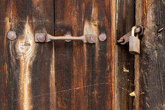 Ornated door and padlock Royalty Free Stock Photography