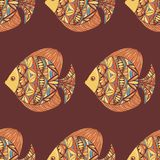 Ornated fish pattern with brown background Royalty Free Stock Photography