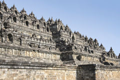 Borobudur pyramid temple walls java indonesia. Ornately decorated walls of ancient stone pyramid in borobudur temple complex in yogyakarta, java indonesia Royalty Free Stock Photo