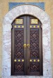 Ornately decorated wood and brass inlay door of Sarajevo mosque Bosnia Hercegovina. Sarajevo, Bosnia - March 23, 2015: A wooden door decorated with traditional Royalty Free Stock Images