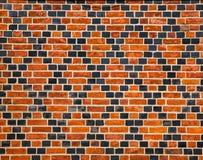 Ornement décoratif fait par les briques rouges et noires Image stock