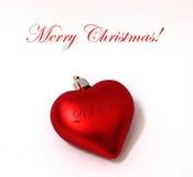 Ornement de coeur de Joyeux Noël Photographie stock