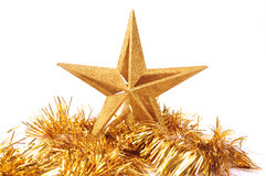 Ornement en forme d'étoile éclatant d'or i de Noël Images stock