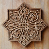 Ornement sur la porte en bois Photographie stock