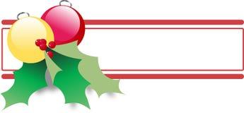 Ornements de Noël avec le houx Photo stock