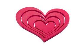 Ornements en forme de coeur sur un fond blanc Photo stock