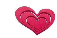 Ornements en forme de coeur sur un fond blanc Photographie stock