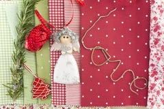 Ornements et fond de Noël de tissus Photo stock