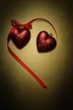 Ornements rouges de coeur de scintillement Photos stock