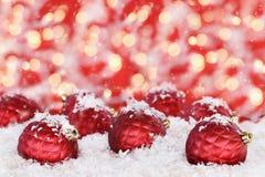 Ornements rouges de Noël Photographie stock libre de droits