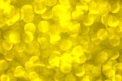 Oro abstracto del bokeh para el fondo de la Navidad defocused Imagen de archivo libre de regalías