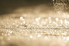 Oro abstracto texturizado del brillo del fondo Foto de archivo libre de regalías