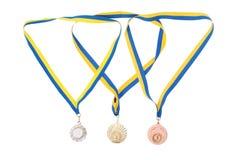 Oro, argento e medaglie di bronzo isolate su bianco Immagine Stock Libera da Diritti