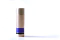 Oro Brown y botella plástica púrpura para la crema de la belleza aislada Imagen de archivo