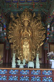 Oro Buda armado multi Foto de archivo
