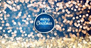 Oro chispeante y luces de plata de Navidad con ornamento de la bola del mensaje del saludo de la Feliz Navidad y de la Feliz Año  fotos de archivo
