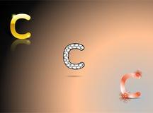 Oro, colori in bianco e nero e arancio con la lettera C fotografie stock