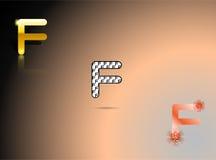 Oro, colori in bianco e nero e arancio con la lettera F fotografie stock
