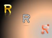 Oro, colori in bianco e nero e arancio con la lettera R fotografie stock