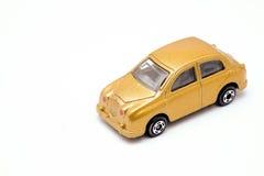 Oro del juguete del coche Imagen de archivo