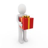 oro di colore rosso del contenitore di regalo dell'uomo 3d Fotografie Stock Libere da Diritti