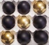 Oro di Pasqua ed uova nere Immagini Stock Libere da Diritti