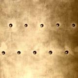 Oro di piastra metallica o struttura dell'armatura con i ribattini Fotografia Stock