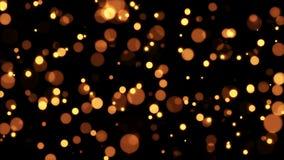 Oro Dots Sparks que brilla en fondo negro almacen de video