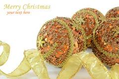 Oro e decorazioni arancioni di natale Fotografie Stock