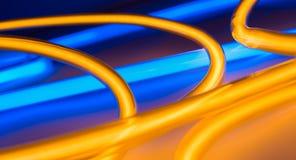 Oro e luci al neon blu, concetto leggero astratto immagine stock libera da diritti
