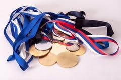 Oro e medaglie di argento Immagini Stock