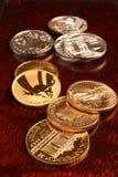 Oro e monete d'argento Fotografia Stock
