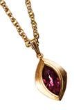 Oro e pendente del rubino sulla catena Fotografie Stock Libere da Diritti