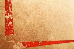 Oro e reticolo rosso come priorità bassa Fotografia Stock Libera da Diritti