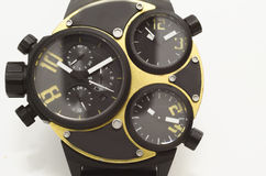Oro ed orologio del nero Fotografia Stock
