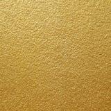 Oro giallo brillante della foglia del fondo di struttura della parete Fotografia Stock Libera da Diritti