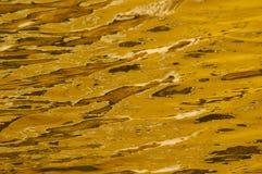 Oro liquido Immagine Stock