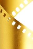 Oro macro della pellicola da 35 millimetri Fotografia Stock
